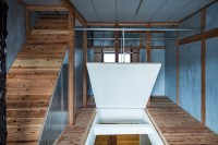 persimmon hills brings light into japan home with trap door