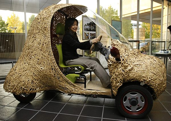 """Bamgoo"", an electric car with a body made out of bamboo, is displayed in Kyoto"