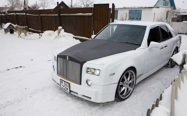 Ruslan Mukanov, a 24 year-old car mechanic, drives his home-made replica of a Rolls-Royce Phantom in the town of Shakhtinsk
