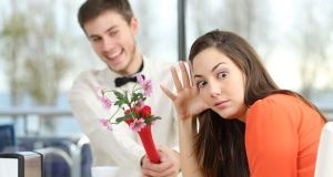 Woman rejecting a geek boy in a blind date