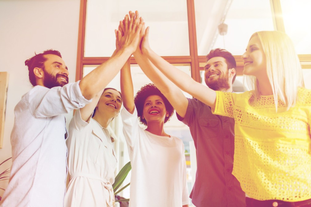 business, startup, gesture, people and teamwork concept - happy creative team making high five in office