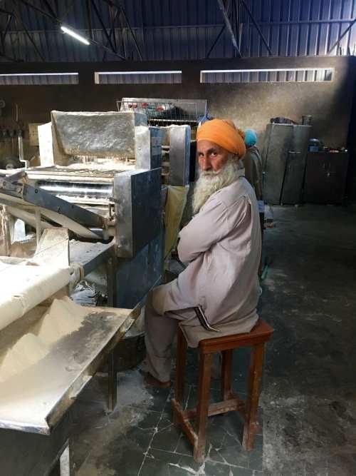 A Sikh making Chapati