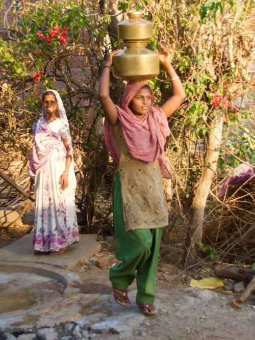 Carrying water in village near Kavant