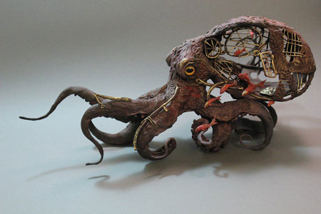 octopus_with_fish_by_creaturesfromel-d5qut6k