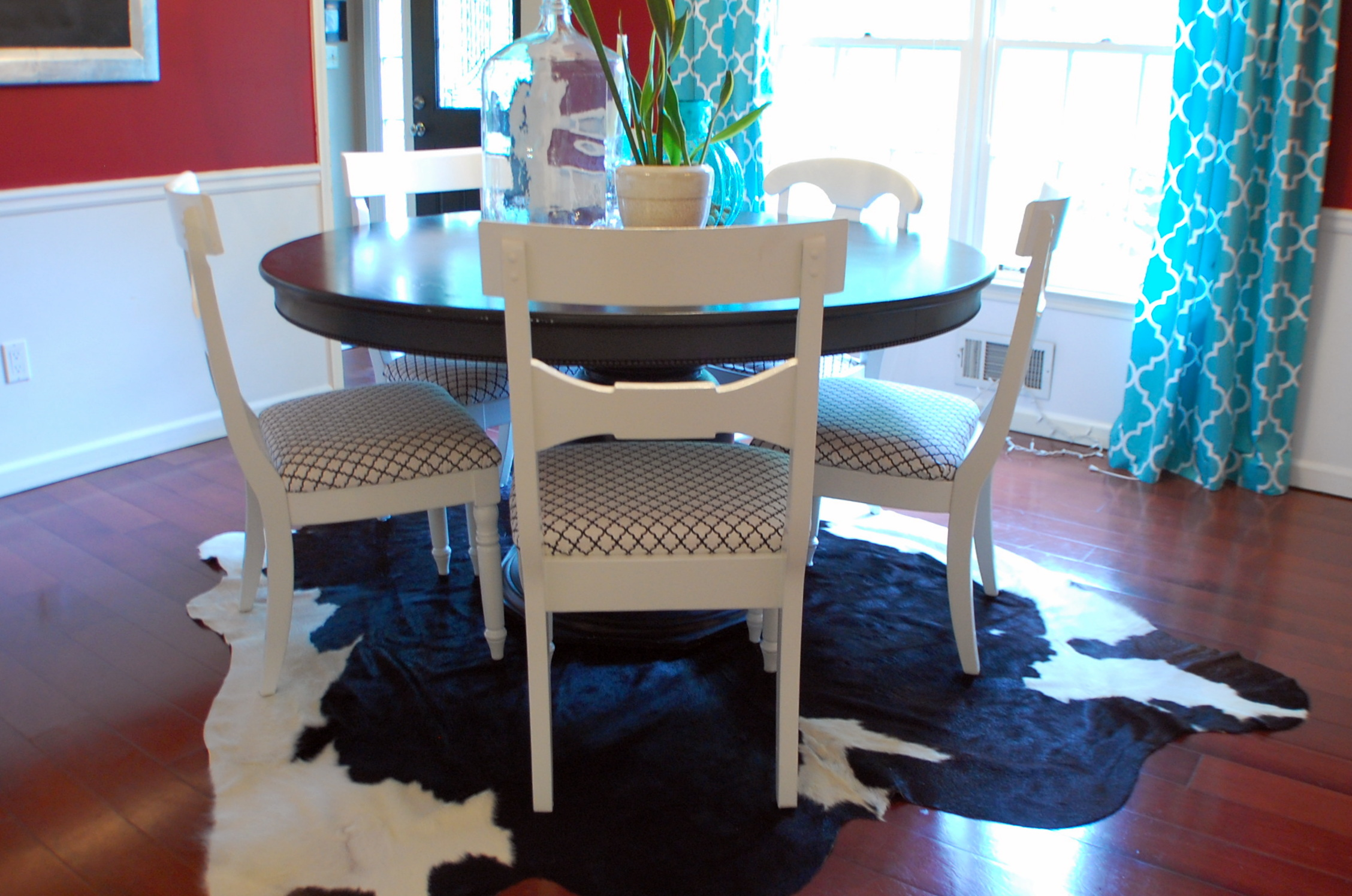dining room rug rugs under kitchen table Cowhide