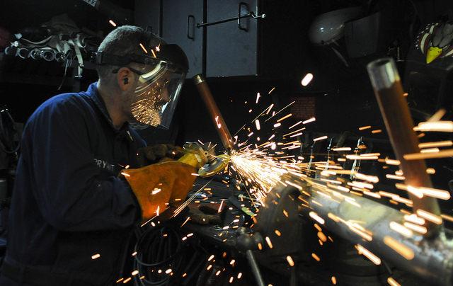 110708-N-OM642-588 BALTIC SEA (July 8, 2011) Hull Technician 1st Class Kenneth Bryant grinds a weld on a damage control training pipe patching aid aboard the guided-missile frigate USS Carr (FFG 52). The pipe will help Sailors build their damage control pipe patching skills. Carr is on a scheduled three-month deployment supporting maritime security operations and theater security cooperation efforts in the U.S. 6th Fleet area of responsibility. (U.S. Navy photo by Mass Communication Specialist 1st Class Gary Keen/Released)
