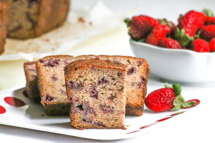 Strawberry Bread is loaded with fresh Florida strawberries. Some are chopped and some are cooked on the stove before they are all folded into the batter. #SundaySupper #FLStrawberry