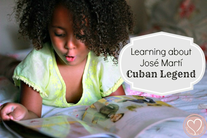biracial baby girl reading hispanic heritage month cuban book