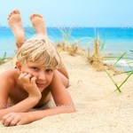 depositphotos_1913836-Young-blond-boy-lying-on-the-beach