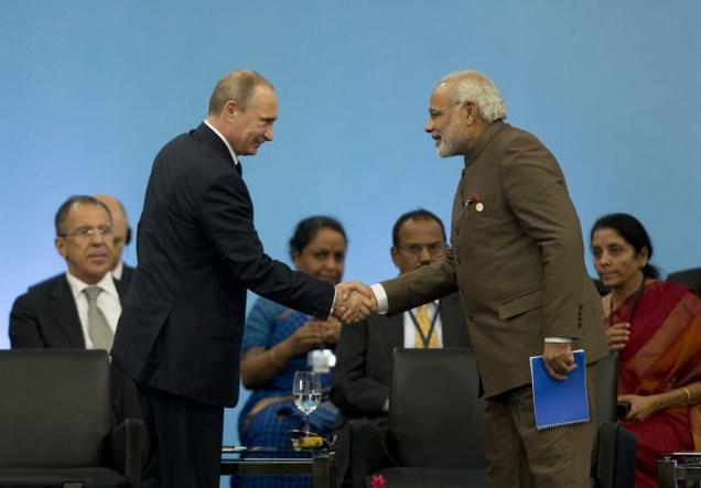 Russia's President Vladimir Putin greets Prime Minister Narendra Modi at the BRICS 2014 summit in Fortaleza, Brazil on Tuesday. Photo: AP