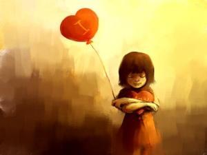 niña-con-un-globo-en-forma-de-corazon