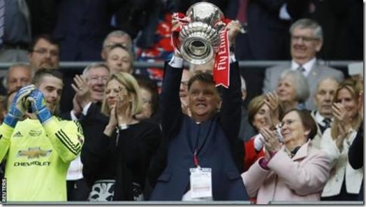 Louis van Gaal lifts the FA Cup