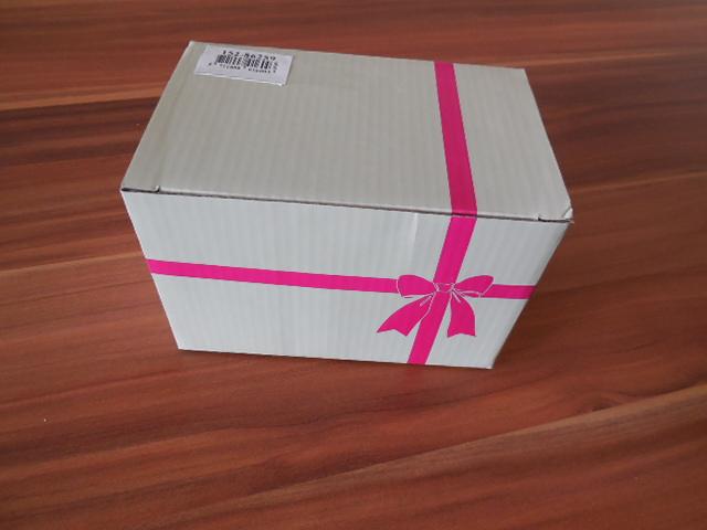 in diesem hübschen Geschenkpaket wurde die Spardose verschickt