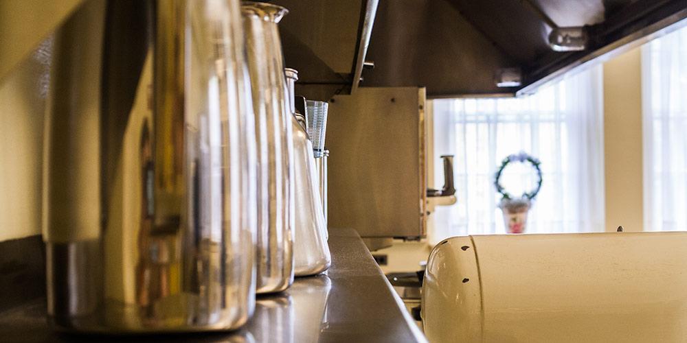 Milk jugs in a kitchen.