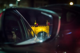 The Smithfield Street Bridge in Pittsburgh, PA is seen in the rearview mirror. July 2015.
