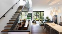 Modern Suburban Home With A Mirrored Staircase - DigsDigs