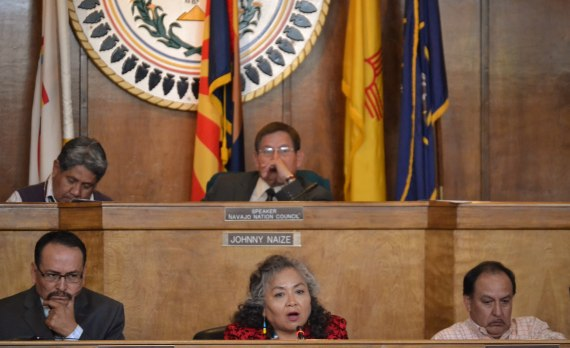 Navajo Council Delegate Katherine Benally presents her proposed Navajo Nation Chapters' Capital Improvement Project plan to Council at Council chamber in Window Rock, Ariz., on April 22, 2014. Benally is flanked by Navajo Division of Community Director Leonard Chee on her right and Navajo CIP Program Director Casey Begay. Speaker Pro Temp LoRenzo Bates listens to her report. Legislative staff Michael Martinez operates electronic voting machine. Photo by Marley Shebala.