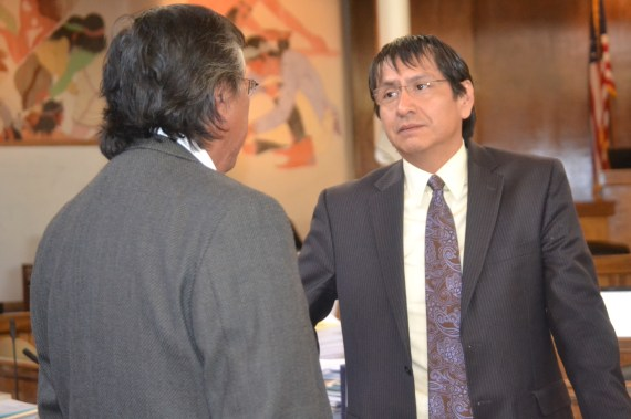 "(L-R) Navajo Council Delegates Leonard Tsosie and Jonathan Nez were among the 13 delegates to vote ""Yes"" on a $554 million settlement of a lawsuit filed by the Navajo Nation against the U.S. for alleged misuse of tribal trust fund. The Council votes was 13 in favor, 3 opposed on May 30, 2014. Photo by Marley Shebala"