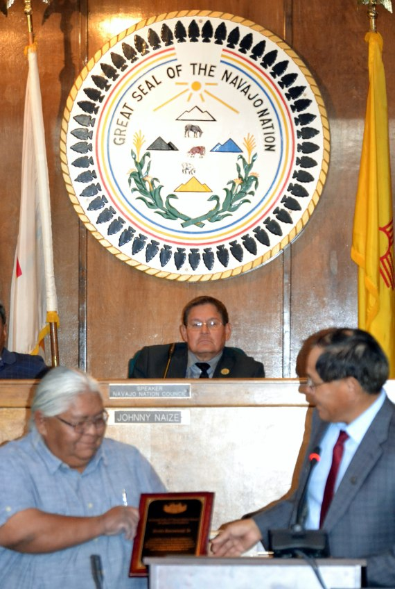 (L-R) Former Navajo Nation Council Delegate Ervin Keeswood Sr. is honored by Delegate Lorenzo Curley on behalf of the Council on June 6, 2014, in the Council chamber in Window Rock, Ariz., for initiating legislation in 2006 to sue the U.S. for mismanagement of tribal trust funds and resources  that resulted in a $554 million settlement. Photo by Marley Shebala.