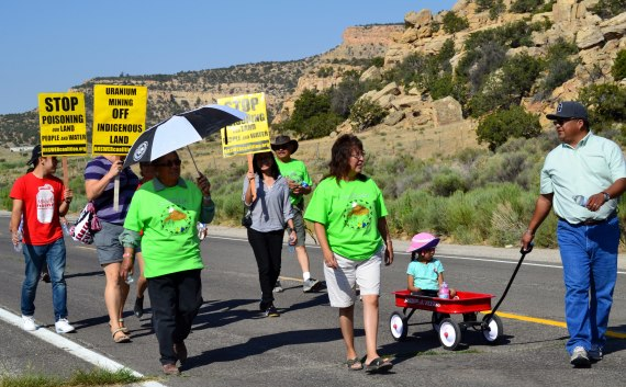 Navajo Council Delegate Edmund Yazzie, who was pulling a wagon that his daughter sat in, was among about a hundred people that walked to the site of a 1979 nuclear disaster near Church Rock, N.M., on July 19, 2014. Photo by Marley Shebala. (Please provide proper photo credit when reusing photo.)