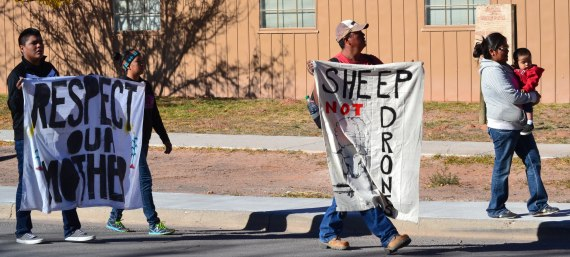 The peaceful walk from the Window Rock Mini-Mall to the Navajo Council chambers on Oct. 30, 2014, included people of all ages, who came from Big Mountain and Black Mesa to get assistance from the Navajo Nation government to stop the brutal impoundment of their livestock by Hopi police and federal rangers since mid-October on the Hopi Partition Lands. Photo by Marley Shebala. (Please provide proper photo credit when reusing photo.)