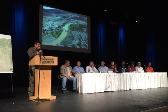 Speaker LoRenzo Bates addresses the public and New Mexico State Environment Department Secretary Ryan Flynn, State Engineer Tom Blaine, as well as San Juan County, City of Farmington, and City of Aztec representatives at a public meeting held at the Farmington Civic Center on August 8, 2015. Courtesy photo.