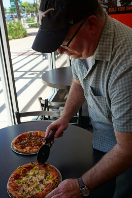 Owner Doug Cutting my Fresh Pizza