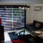Living room with blinds partially closed