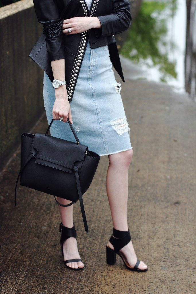 studded leather jacket and distressed denim skirt