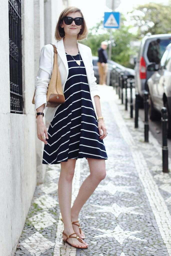 white blazer and navy striped dress