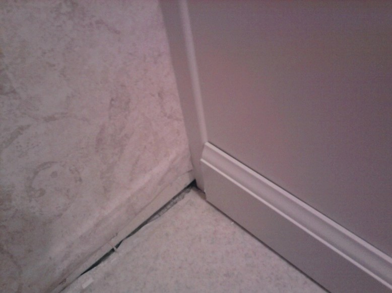 Install Baseboard Over\/around Existing Trim Of Bathroom Vanity - bathroom baseboard ideas