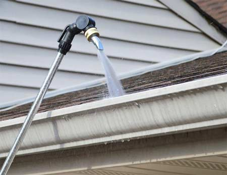 How To Clean Gutters From A Ladder Or Ground Level And