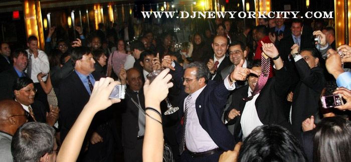 Photo of multicultural corporate party aboard a yacht cruise around lower and midtown Manhattan.