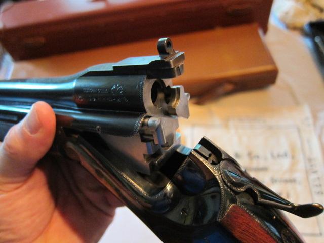 InterstingPeep sight on over under shotgun The art of war - firearm bill of sales