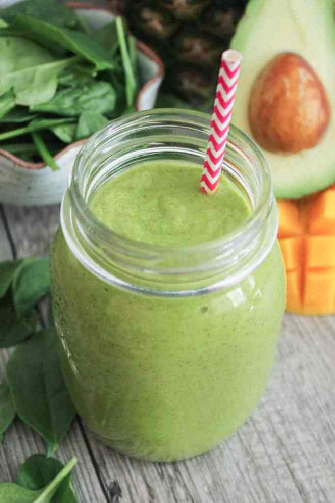 vegan-tropical-green-smoothie-with-avocado-spinach-mango-pineapple-and-chia-seeds