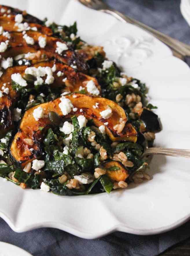 farro-with-chipotle-glazed-acorn-squash-kale-pepitas-feta