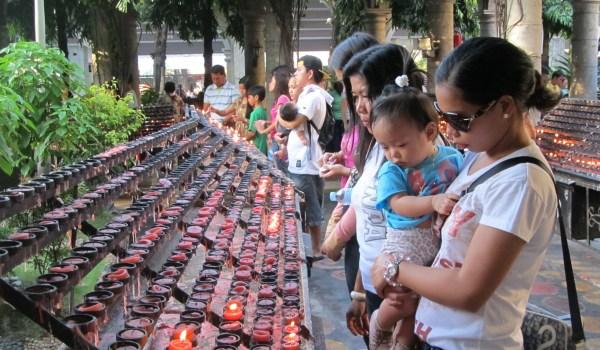 Candle_Lighting_for_Prayer_at_Sto._Nino_Church,_Cebu_Philippines