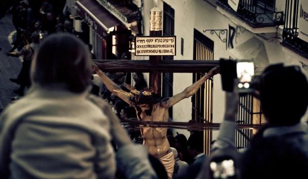 Praying before a Crucifix.