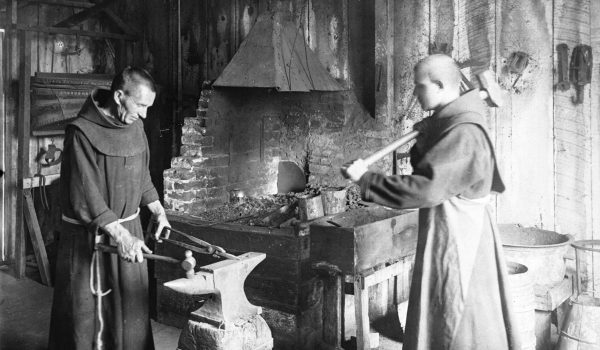 Two_monks_working_in_the_blacksmith_shop_at_Mission_Santa_Barbara,_ca.1900_(CHS-4070)