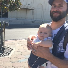 bearded father with child in a carrier