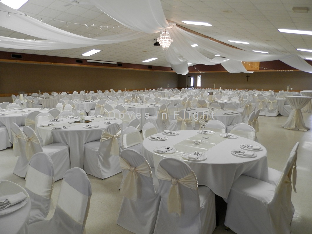 Square crystal pin on ivory sash westphalia fitted chair covers