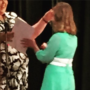 Juliet receiving her certificate for completing elementary school.