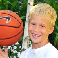 Bonde boy, Cooper Smith holding a basketball