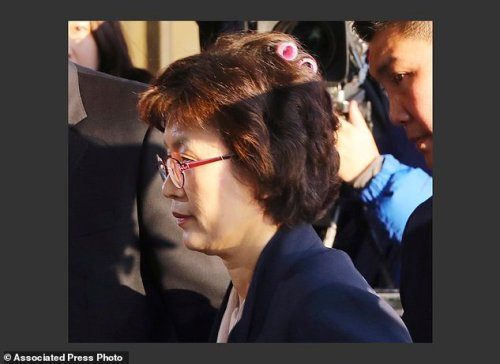 Acting Chief Justice Lee Jung-mi arrives with curlers in her hair at the Constitutional Court in Seoul, South Korea, Friday, March 10, 2017. In a historic, unanimous ruling Friday, South Korea's Constitutional Court formally removed impeached President Park Geun-hye from office over a corruption scandal that has plunged the country into political turmoil and worsened an already-serious national divide. (Kim Ju-sung/Yonhap via AP) KOREA OUT