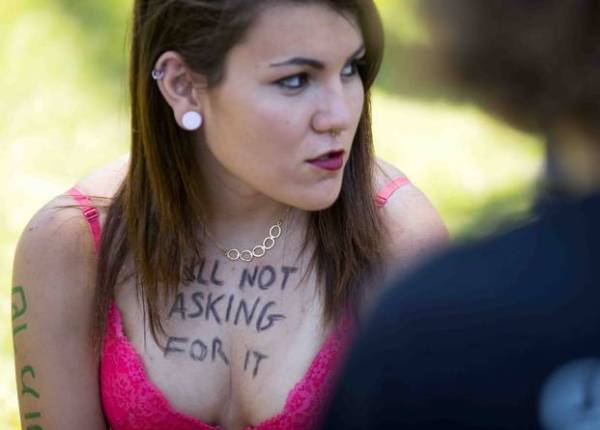 "Woman at an Israeli Slut Walk with the words ""still not asking for it"" scrawled across her exposed chest."