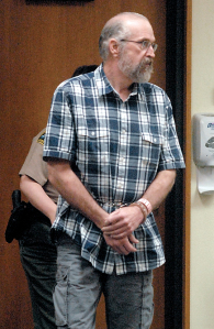 Keith Thorpe/Peninsula Daily News Douglas Allison enters Clallam County Superior Court in Port Angeleson Wednesday for his first appearance on charges of child molestation and first=degree rape of a child.