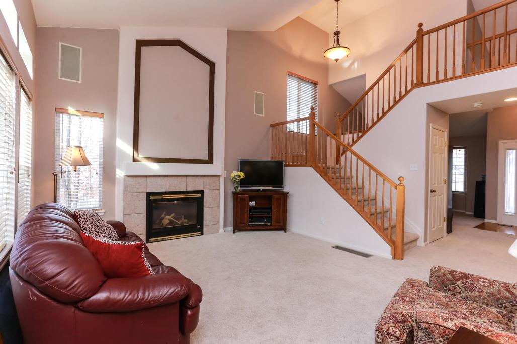 Looking back towards the front of the home. Beautiful staircase and fireplace focal walls!