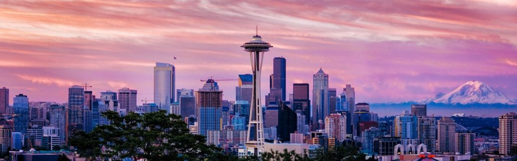 Seattle Sunrise with Space Needle in the middle. Photo by CEBImagery via Flickr CC