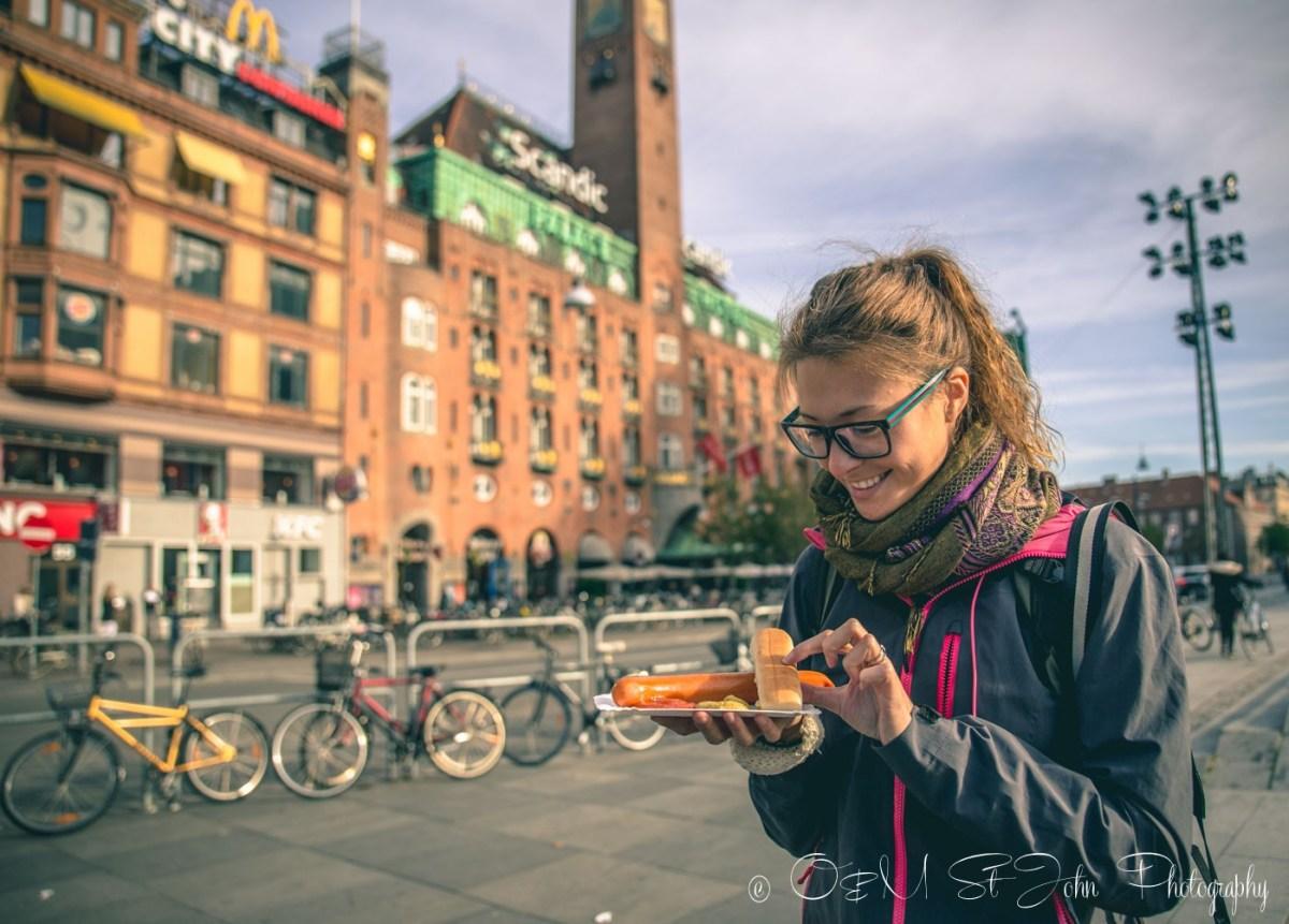 Oksana eating hot dog in Copenhagen. Denmark
