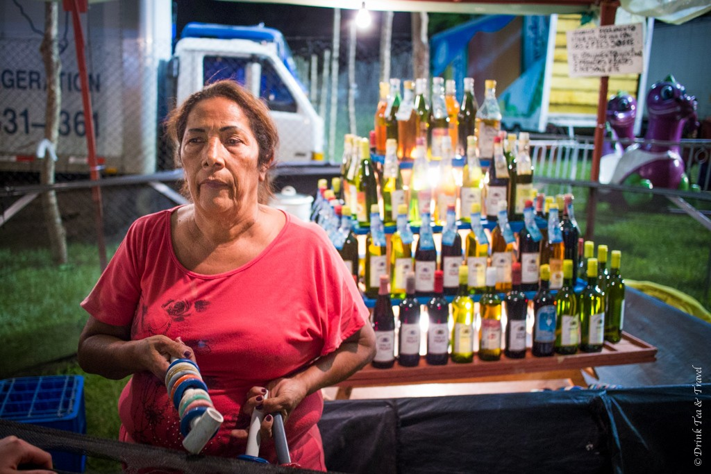 Luck wasn't always on our side. Woman at the local version of the ring toss game. Costa Rica, Fiesta